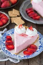 Fresh strawberry mousse pie with real strawberry puree and a homemade graham cracker crust
