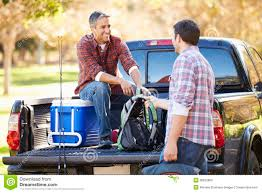 100 2 Men And Truck Two Unpacking Pick Up On Camping Holiday Stock Photo