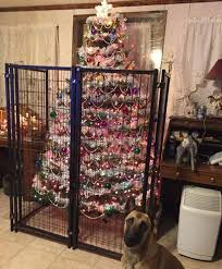 Saran Wrap Christmas Tree With Ornaments by 15 Genius People Who Found A Way To Protect Their Christmas Trees