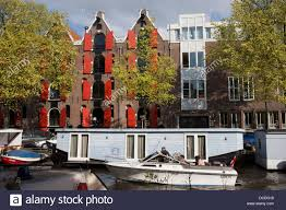 100 Warehouse Houses Canal In Amsterdam With Boats And Apartment Houses Former Warehouse