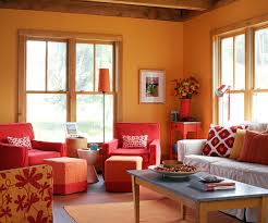 Here Bursts Of Orange Brighten The Charming Living Room Bold Accent Color Looks Shocking Against Icy Blue Walls But This Unexpected