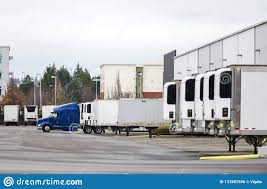 100 Semi Truck Trailers Big Rig And Standing In Row In Warehouse