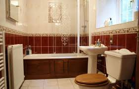 Bathroom Tile Colour Schemes by Ceramic Tile A Bathroom Wall Dark Brown Wood Vertical Cabinet
