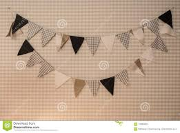 100 Decorated Wall With Triangle Shape Of Fabric Hanging Stock Photo