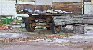 Old Broken Trailer With Trash Stock Photo
