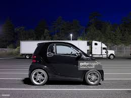 Smart Car And Semi Truck Stock Photo   Getty Images Smart Car Glorified Truck Battery Youtube 2013 Electric Smtcar Drneon 1999 Fortwo Specs Photos Modification Info At Cardomain Dtown Austin Texas Not A Food But A Food Smart Car Repairs North West Mechanics Lift Kit For Fortwo Forums Memoirs Of Conservative In My Nonvegan High Speed Jet Powered Yes Jet Powered Sew Ez Quilting Vs Our Truck 2017 Smtcar Hydroplane Wreck