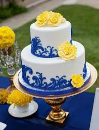 gorgeous cake decortated in blue yellow & white luv the damask design in royal blue and the fluffy yellow flowers