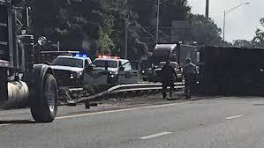 FHP: Dump Truck Overturns On I-10 After Crash With Car