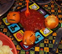 Picture Of Pumpkin Throwing Up Guacamole by Halloween Food Occasions And Holidays