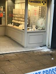 The Front Window Is Seen Smashed And A Hammer Lies On Ground Photo
