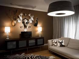 Brown Accent Wall With Zebra Printed Rug For Charming Family Room Moose Decor Ideas