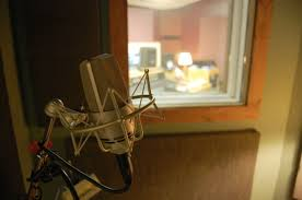 The Microphone In Vocal Booth At Silver Star Recording Music Studio Is Illuminated By Light