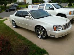 22″ Chrome Milanni Witchy Wheels on a 2000 Cadillac Deville
