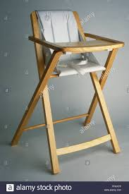 Baby's Fold-out High Chair With A Wooden Frame And White ... Alpha Bouncer 2 In 1 Grey Hauck Wooden Highchair Fniture Oak Bar Stools Target For Inspiring Unique White East Coast Folding Chair High Legs Stock Photo Edit Now Adjustable Baby Infant Seat Child Wood Toddler Dolls High Chairs Doll Chair Stool Color Good Cdition Home Us 324 45 Offhigh Quality 112 Dollhouse Miniature Ding Simulation Decoration Accessoryin White Wooden Reference Images Items Amazoncom Hot Sale Sepnine New Highchair Best Caps Replacement Tire Lowes