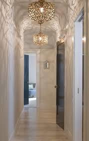hallway lighting transitional with brass pendant lights