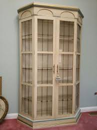 7 foot lighted curio cabinet with glass shelves for sale