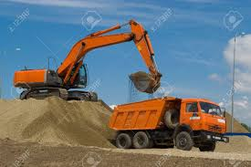 100 Dump Trucks Videos Excavator And Truck At The Building Site Stock Photo Picture