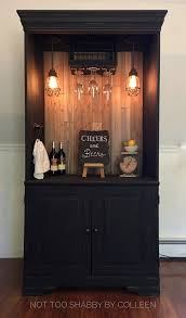upcycled repurposed armoire converted into a dry bar liquor
