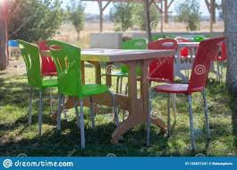 Plastic Table And Chairs Outside In A Garden On Green Lawn Stock ... All Weather Outdoor Patio Fniture Sets Vermont Woods Studios Small Metal Garden Table And Chairs Folding Cafe Tables And Chairs Outside With Big White Umbrella Plant Decor Benson Lumber Hdware Evaporative Living Ideas Architectural Digest Superstore Melbourne Massive Range Low Prices Depot Best Large Round Outside Iron Home Marvellous How To Clean Store Garden Fniture Ideas Inspiration Ikea