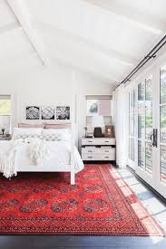 White Bedroom With Bright Red Rug Black Accents Pantone Flame