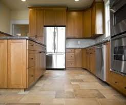 A Neutral Colored Tile Floor Is An Ideal Pairing For Light Maple Kitchen Cabinets