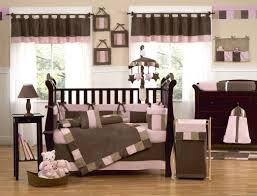 Brown And Blue Bedding by Black Wooden Cradles With Pink Brown Bedding Placed On The Brown