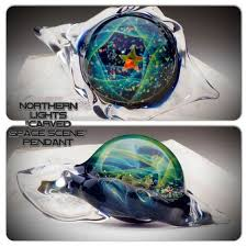 Northern Lights Carved Space Pendant $400 at TheHeadyHive