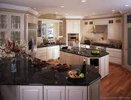 Kitchen With Antique White Cabinets Black Countertops