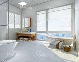 modernes und geräumiges badezimmer mit badewanne waschbecken wc und dusche sonnenlicht durch große deckenhohe fenster design stockfoto und mehr bilder