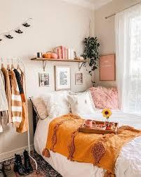 comfy and cosy bedroom corner with burnt orange boho