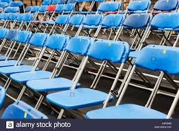 Rows Of Folding Chairs, Oxford University, Oxford, Oxfordshire ... Sports Chair Black University Of Wisconsin Badgers Embroidered Amazoncom Ncaa Polyester Camping Chairs Miquad Of Cornell Big Red 123 Pierre Jeanneret Writing Chair From Punjab Hunter Green Colorado State Rams Alabama Deck Zokee Novus Folding Chair Emily Carr Pnic Time Virginia Navy With Tranquility Navyslate Auburn Tigers Digital Clemson Sphere Folding Papasan Plastic 204 Events Gsg1795dw High School Tablet Chaiuniversity Writing Chairsstudy