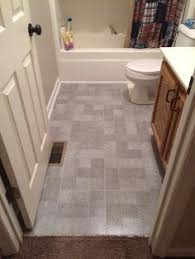 trafficmaster ceramica 12 in x 24 in coastal grey resilient