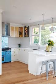 Fresh White Kitchen With Blue Stove
