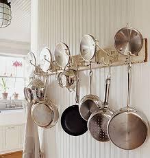 DIY Pot Rack Ideas An ordinary coat rack finds new life as a pot