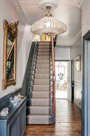 The Large Gold Guilt Mirror Is A Perfect Accent To Grey Walls And Staircase