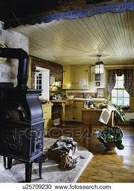 Stock Photography Of Log Farmhouse Kitchen With Cast Iron Wood Stove And Butcher Block Table Counters Wide Plank Floor Vegetables Harvested From