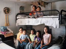 Seven Mexican Immigrant Children Inside An Old Mobile Home Where They Live With Their Single