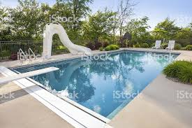 Idyllic Swimming Pool With Slide Diving Board Royalty Free Stock Photo