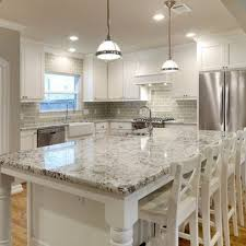 white granite countertops and glass subway tile backsplash but