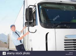 Truck Driver Looking At Camera Stock Photos & Truck Driver Looking ... Woman Truck Driver Looking Out The Door Of A Big Rig From Stock Driver Shortage In Industry Baku Experience Life Trucker Truck On Xbox One Looking In Sideview Mirror Photo Getty Images Military Veteran Driving Jobs Cypress Lines Inc Owner Operator Application Are You For Traing Brisbane We Are Good Garbage Waste Management Trains Senior Throw The Window Picture Male Out Of Image Forwarding Sits Cab His Orange Edit Now 18293614 Guy Pickup At Shotgun Video Footage Videoblocks