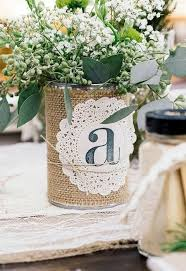 A Tin Can Wrapped With Burlap And Doily Greenery Flowers For