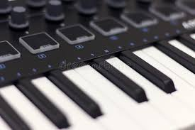 Download Midi Keyboard Is White Close Up Modern Electronic Music Studio Equipment