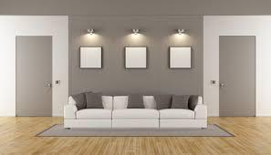 minimalist wohnzimmer mit zwei geschlossenen türen und weißen sofa 3d rendering