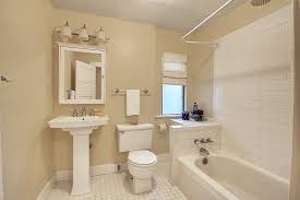 traditional full bathroom with arched window ceramic tile floors