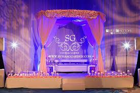 Suhaag Garden Indian Florida Wedding Decorators Event Design Decor Hilton Orlando Bonnet Creek Reception Stage Pink Drapes Roses