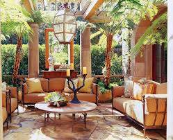 Living RoomContemporary Tropical Themed Sun Room With Unique Glass Hanging Lantern And Brown Sectional