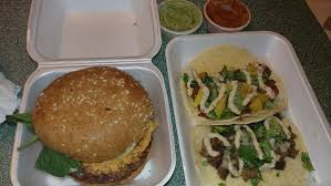 Tacos And A Burger From A Vegan Food Truck. : Vegetarian Vegan Food Truck Festival In Boston Tourist Your Own Backyard Nooch Market Van Brunch Service 11am 2pm Come Get Two Women Ordering Food At A Street Truck Vancouver Signs On Vegan Washington Dc Usa Stock Photo 72500969 Sacramento Sacmatoes The Moodley Manor In Ireland April 2014 Regular Business Plan 14 Best Hot On Go Hella Eats San Francisco Trucks Roaming Hunger Meditation Jacksonville So Cal Gal
