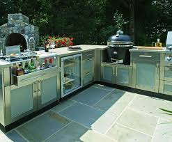 This Large L Shaped Outdoor Kitchen Design Includes Paneled Cabinetry By Danver A Bar