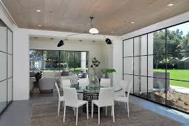 contemporary dining room with high ceiling slate tile floors in