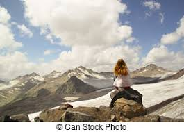 Young Girl Sitting On The Edge Of A Cliff And Looking At Sky